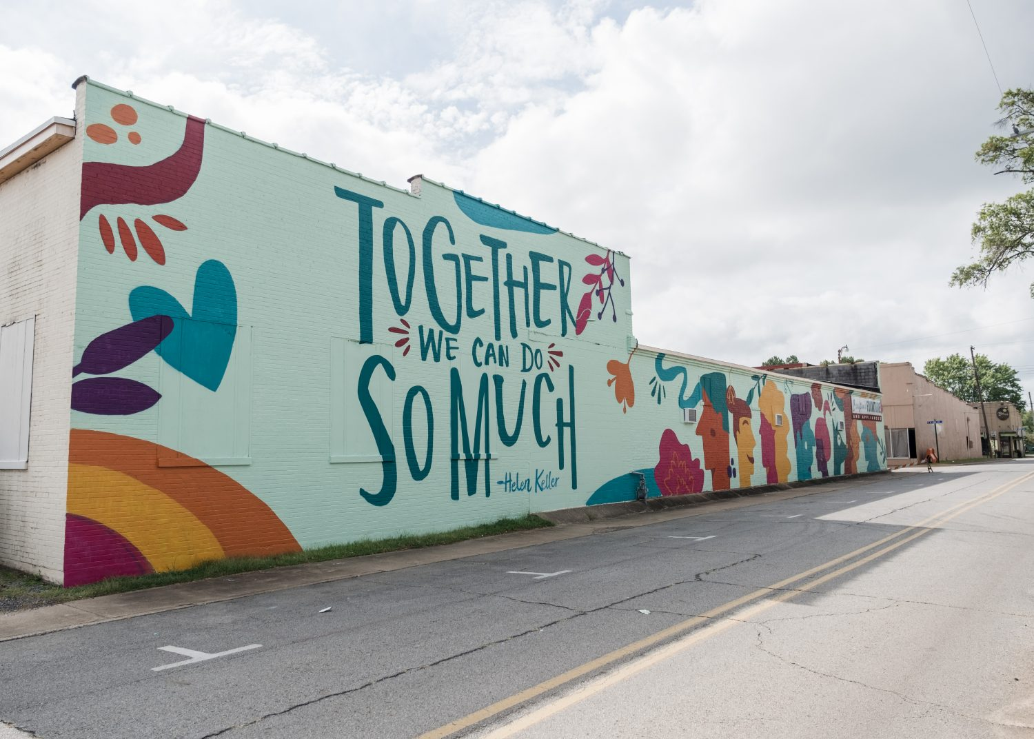 "The ""Together We Can Do So Much"" mural can be viewed on the northwest side of Downtown Searcy."