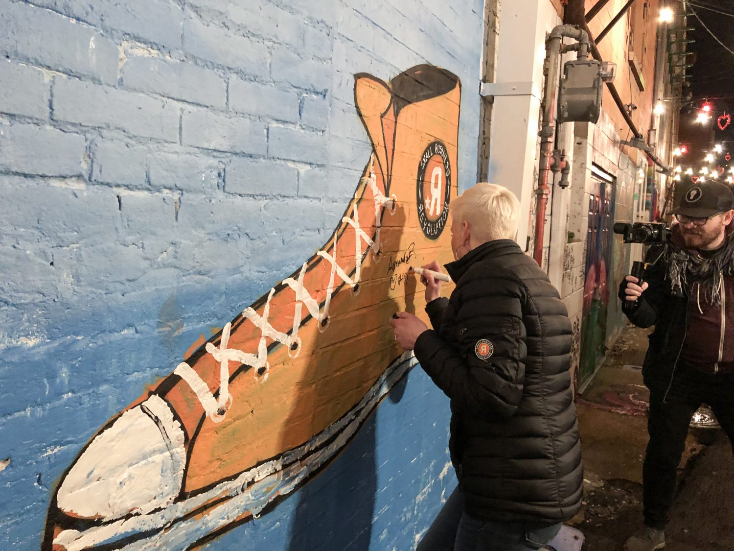 "SBR's Amanda Brinkman made sure to sign the ""Shoe"" mural in Art Alley while she was in town."
